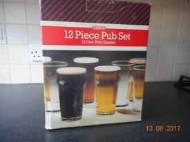 12 TESCO ONE PINT GLASSES