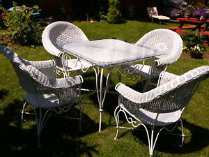 Wicker and rod iron table and 4 chairs