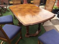 Extending table and 6 padded chairs