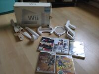 Fully working Nintendo Wii with 5 games for sale just don't use anymore