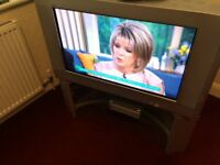 TV Sony 30 inch screen and stand. With remotes and digital converter box. Still has a good picture