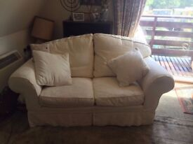 2 Feather down Sofas, cream washable covers. 2 seaters but easily seats 3 . Armchair