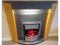 Electric fire with surround and lighting