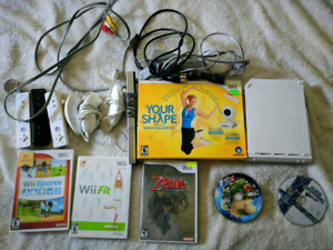 Wii with lots of accessories a few games