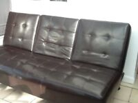 Sofa bed. Dark brown colour.
