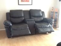 Black Leather 2 seater recliner sofa.