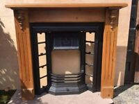 Cast iron traditional Stovax fireplace (without tiles) and waxed pine mantle surround .