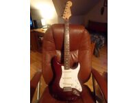 2006-07 FENDER STRATOCASTER IN MIDNIGHT WINE WITH FENDER NOISELESS PICKUPS EXCELLENT CONDITION