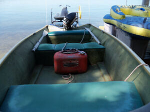12 ft. fishing boat with 7.5 Mercury for sale.