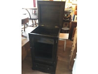 Ercol Dark Elm Music Cabinet , but could be used as a normal storage cabinet .