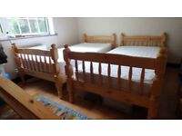Bunk beds (or 2 singles), solid pine, with mattresses and covers, excellent condition