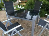 Garden table & four folding chairs
