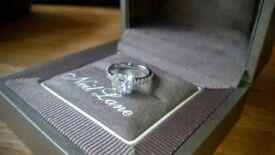 Neil lane engagment ring diamond 0.81 carat 14ct white gold band with diamond shoulders.