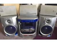 Blue and silver 3 CD player with speakers