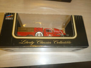 Two Canadian Tire Liberty Classic collectible trucks