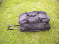 HOLDALL WITH WHEELS AND PULL ALONG HANDLE - NEW