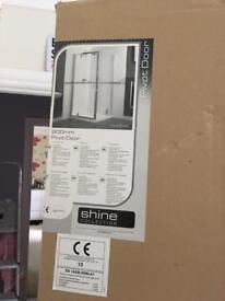 Brand new unopened 900mm pivot shower door