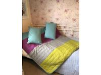 King size IKEA bedspread and two matching cushions