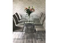 Glass dinning table & 6 suede chairs