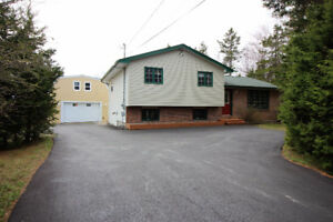 NEW PRICE - Beautiful Home,Detached Garage, Spa Hut on 3/4 Acre