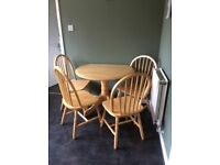 Pine drop leaf table and 4 chairs, good condition