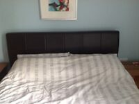 Nearly new brown faux leather ottoman king size bed frame with mattress, great for storage.
