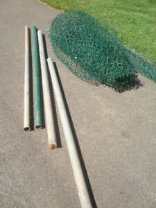 Four fence posts and some green fencing