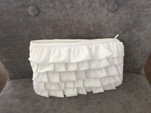 Pure white, romantic ruffled clutch perfect to go with your wedd
