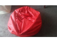 Giant red faux leather bean bag