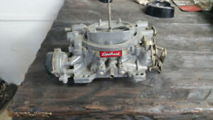 Bush guard and 1406 edelbrock carborater