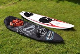 Surfboard with foot pads and straps for towing. Includes boardbag, leash and tow rope.