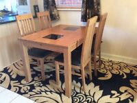 Light oak dining table and four chairs