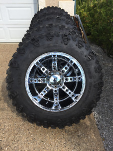 "41"" Irok Super Swampers on 22x14 KMC XD Diesel 8x170 Pattern"