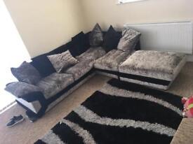 Silver black sofa with footon