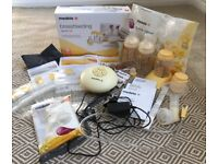 Medela Swing breast pump and breastfeeding starter kit