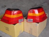 VW Golf Mark 4 tail lights complete with bulb carriers. AS NEW CONDITION.