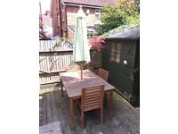 Garden table, chairs and umbrella for sale £175 ONO