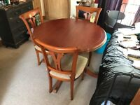 Large extending solid wooden dining table with 4 chairs RRP £800