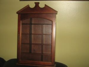 small curio cabinet for the wall.