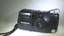 Olympus MJU Zoom camera with 35-70mm lens .