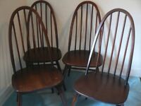 Four genuine vintage Ercol Quaker spindle back chairs in v g condition, original seatpad studs