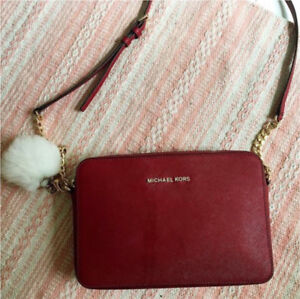 Small Michael Kors purse for trade.