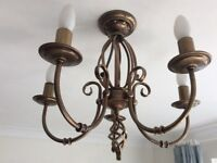 Two small brass chandeliers