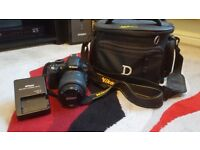 Nikon D3100 body with Nikkor 18-55mm lens and Nikon D series bag