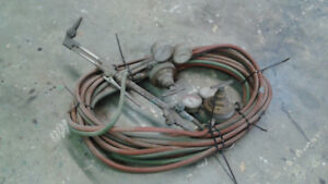 Cutting torch with hoses