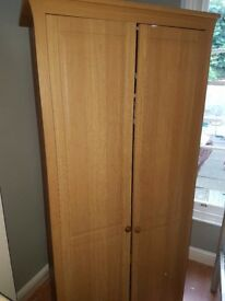 Wood finish wardrobe and chest of drawers