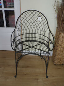 Lovely metal framework chair with cream cushion