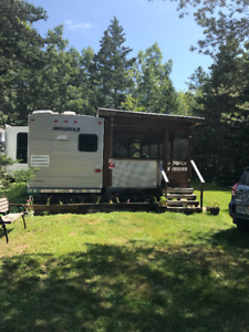 """34.6"""" Travel Trailer with new screened in porch size of trailer"""