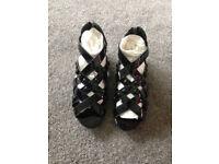 Black patent Kurt Geiger sandals