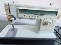 Electric Singer 507 Sewing Machine (1973) includes instruction manual.